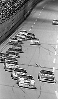 #25 Chevrolet Lumina driven by Ken Schrader leads a pack of cars during the DieHard 500, NASCAR Winston Cup race, Talladega Superspeedway, July 26, 1992.  (Photo by Brian Cleary/bcpix.com)