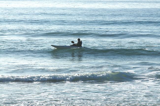 Ocean Kayaker in late afternoon surf
