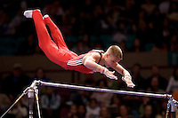 3/1/08 - Photo by John Cheng - Alexander Artemev of the United States performs on the high bar at the Tyson American Cup in Madison Square GardenPhoto by John Cheng - Tyson American Cup 2008 in Madison Square Garden, New York.Artemev