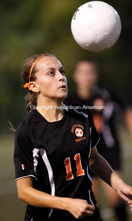 Waterbury, CT- 21, September 2011-092111CM13 NEWS ACTION WOMAN Watertown's Alexandra Mahar goes up for the ball during NVL girls soccer action against Holy Cross at Municipal Stadium in Waterbury Wednesday night.  Watertown won 1-0. Christopher Massa Republican-American