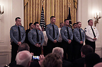 Washington, DC - September 9, 2019: President Donald J. Trump presents the Medal of Valor to 11 police officers and civilians who responded to the recent mass shootings in Dayton, Ohio. The ceremony was held in the east Room of the White House, September 9, 2019. (Photo by Lenin Nolly/Media Images International)