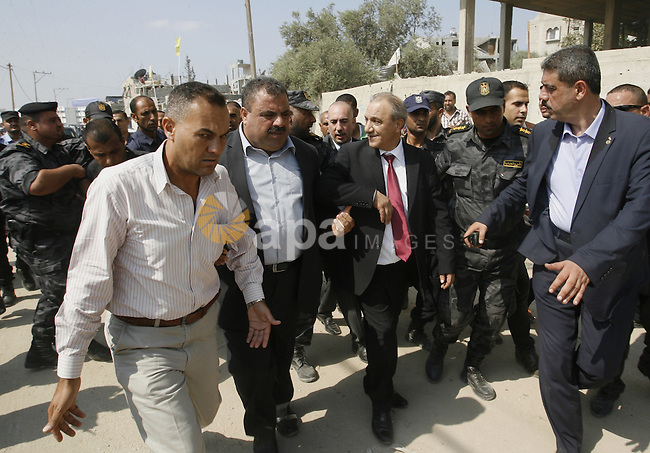 Palestinian intelligence chief, Majed Faraj, arrives to the Beit Hanoun in the northern Gaza Strip on October 9, 2014. The Palestinian unity government which took the oath of office in June under technocrat prime minister Rami Hamdallah arrived to Gaza Strip on Thursday to convene the first fully meeting. Hamdallah said that the unity government will rebuild the bombed-out Gaza Strip following a seven-week Israeli offensive. Photo by Abed Rahim Khatib