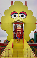 FILE-A boy climbs down the steps at an amusement  play area at Sesame Place in Langhorne, PA., July 30, 1996. The mouth of the steps are in the shape of Sesame Street's Big Bird character.  (photo by William Thomas Cain)