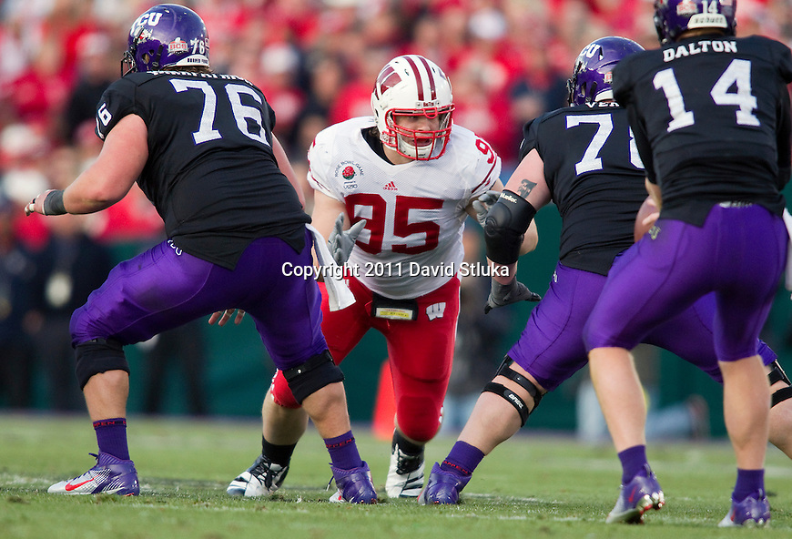 Wisconsin Badgers defensive lineman Patrick Butrym (95) plays defense during the 2011 Rose Bowl NCAA Football game against the TCU Horned Frogs in Pasadena, California on January 1, 2011. TCU won 21-19. (Photo by David Stluka)