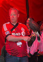 "30 March 2013: Bird handler Rob Wernaart gets ready to introduce Toronto FC's Harris Hawk ""Bitchy"" during an MLS game between the LA Galaxy and Toronto FC at BMO Field in Toronto, Ontario Canada..The game ended in a 2-2 draw.."