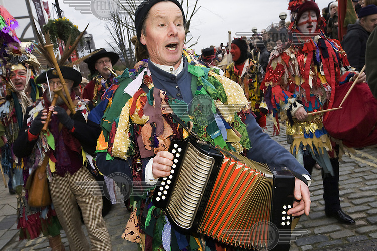 Performers and musicians from The Lions Part company - actors connected with London's Globe Theatre - play instruments to accompany an annual traditional free theatre celebrating a 'wassail' celebration to herald the new year in London.