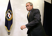 Langley, VA - May 31, 2006 -- United States President George W. Bush takes the stage at the start of a ceremonial swearing in for new Central Intelligence Agency Director General Michael Hayden at CIA headquarters in Langley, Virginia Wednesday 31 May 2006. Hayden, the former head of the super-secret National Security Agency (NSA), was officially sworn-in yesterday by National Intelligence Director John Negroponte in a closed ceremony.<br /> Credit: Matthew Cavanaugh-Pool via CNP