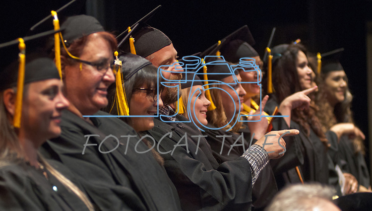 Dave Hardin and fellow students recognize friends and family in the audience at the Western Nevada College commencement in Fallon, Nev., on Tuesday, May 20, 2014. <br /> Photo by Kim Lamb