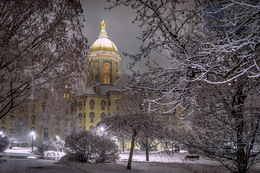 February 17, 2018; Main Building on a snowy night (Photo by Matt Cashore/University of Notre Dame)