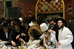 Israel, Bnei Brak, the Rabbi of Premishlan congregation and his hasids rejoice the holiday of Purim with singing and wine at the Synagogue