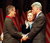 United States President Bill Clinton presents the 1999 National Humanities Medal to producer-director Steven Spielberg at a Washington, DC ceremony on September 29, 1999.  First lady Hillary Rodham Clinton looks on..Credit: Ron Sachs / CNP