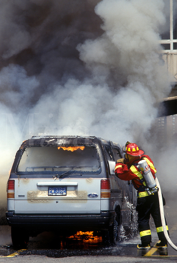 Fireman puts out car fire