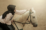A happy woman with horse. Photo by Sanad Ltefa