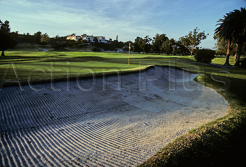 View of the the 10th green and bunker at sunset on The Riviera Golf Club, Los Angeles. Photo: Brian Morgan/actionplus..courses general view views scene scenery spectacular clubs landscape venue American tenth 076 bunkers sand trap traps