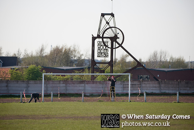 Walsall Wood FC 1 Atherstone Town 0, 02/05/2013. Oak Park, Midland Football Combination Premier Division. Groundsmen putting up the goal nets at Oak Park, home to Walsall Wood FC with the memorial to the former colliery in Walsall Wood in the West Midlands pictured in the background prior to the club's match against Atherstone Town. The club were crowned champions of the Midland Football Combination premier division the previous night due to results elsewhere, their first league win in 61 years. Walsall Wood, who were formed in 1915, won the match 1-0 watched by 69 spectators. Photo by Colin McPherson.