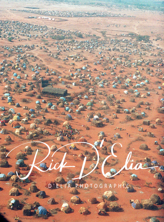 One of the several refugee camps in Mandera Kenya, near the borders of Somalia and Ethiopia. Refugees fled her from Somalia in 1992 to escape the civil war. photo shot from U.S.A.F. C-130 delivering food to the area. More than 100,000 people took up residence in the area. Rick D'Elia