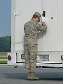 A member of the Army transfer team bows his head in respect as he locks the transfer van with the remains of Sergeant First Class Ricardo D. Young and Staff Sergeant Michael H. Ollis, United States Army, during a Dignified Transfer ceremony at Dover AFB in Dover, Delaware on Saturday, August 31, 2013.  Young and Ollis died supporting Operation Enduring Freedom in Afghanistan.<br /> Credit: Ron Sachs / CNP<br /> (RESTRICTION: NO New York or New Jersey Newspapers or newspapers within a 75 mile radius of New York City)