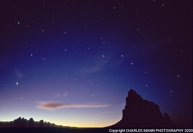 The towering form of Shiprock looms mysteriously beneath the Big Dipper in a time lapse photo of the starry night sky at dusk near the northern New Mexico town of Shiprock.