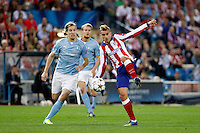 Griezmann of Atletico de Madrid and Filip Helander of Malmoe during Champios Legue soccer match between Atletico de Madrid V Malmoe al Vicente Calderon Stadium. October 22, 2014. (ALTERPHOTOS/Caro Marin)