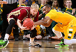 SIOUX FALLS, SD - MARCH 7: Nate Engesser #33 from Denver battles for a loose ball with Lawrence Alexander #12 from North Dakota State University in the second half of their Summit League Tournament game Saturday night at the Denny Sanford Premier Center in Sioux Falls, SD. (Photo by Dave Eggen/Inertia)