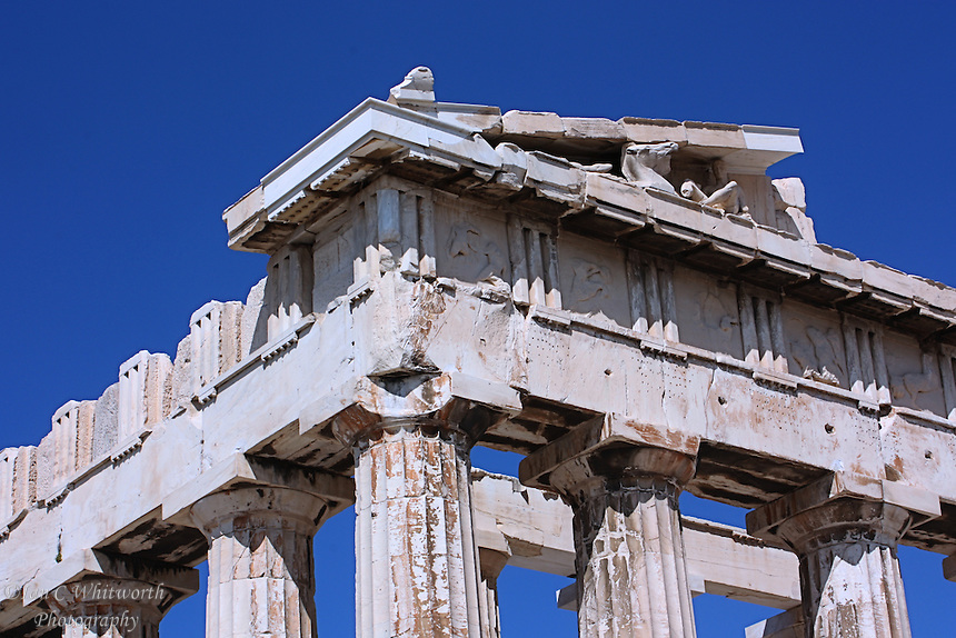 Looking up at the ancient columns and structure at the Acropolis in Athens