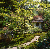 A small oriental-style shed with a thatched roof nestles in the exotic surroundings of the Japanese Garden at Tatton Park