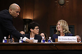WASHINGTON, DC - SEPTEMBER 27:  Senate Judiciary Committee member Sen. Cory Booker (D-NJ) (L) delivers coffee to Christine Blasey Ford (R) as she testifies before the committee in the Dirksen Senate Office Building on Capitol Hill September 27, 2018 in Washington, DC. A professor at Palo Alto University and a research psychologist at the Stanford University School of Medicine, Ford has accused Supreme Court nominee Judge Brett Kavanaugh of sexually assaulting her during a party in 1982 when they were high school students in suburban Maryland.  (Photo by Win McNamee/Getty Images)