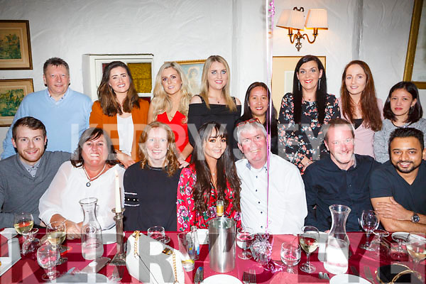 Cloda Curran, seated centre from the Spa, who is leaving the Bons Secours hospital in Tralee and moving to Cork, having a leaving party with her family and friends in Cassidy's on Saturday night last.