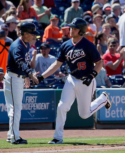 Reno Aces Matt Davidson is congratulated by manager Butler after hitting a home run against the Tacoma Rainiers during their game played on Sunday afternoon, May 26, 2013 in Reno, Nevada.