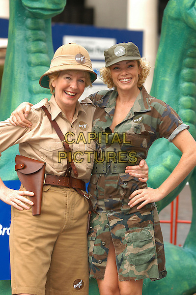 CHRISTINE HAMILTON & NELL McANDREW .launch BT (British Telecom).Broadband internet service.www.capitalpictures.com.sales@capitalpictures.com.© Capital Pictures.safari, fancy dress.army uniform.camoflage