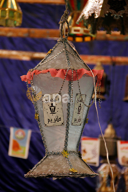 Egyptians hangs Ramadan lanterns (or Fanoos Ramadan) that are displayed for sale at a shop during the Muslim fasting month of Ramadan, in Cairo July 26, 2012. Photo by Amr Mostafa