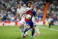Marcelo and James of Real Madrid and Xhaka of FC Basel 1893 during the Champions League group B soccer match between Real Madrid and FC Basel 1893 at Santiago Bernabeu Stadium in Madrid, Spain. September 16, 2014. (ALTERPHOTOS/Caro Marin) /NortePhoto.com