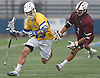 Dylan Alderman #23 of Hofstra University, left, gets pressured by Dylan Gruder #5 of UMass, a 2013 graduate of Smithtown West, during the second quarter of an NCAA Division I men's lacrosse game at Shuart Stadium in Hempstead on Saturday, April 22, 2017. Alderman scored four goals in Hofstra's 15-8 win.