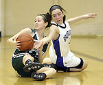 Cloverleaf's Megan Jackson and Brunswick's Mariah Eckrich battle for a loose ball during the fourth quarter. (RON SCHWANE / GAZETTE)