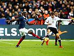 Frankrijk, Parijs, 13 november 2015<br /> Oefenwedstrijd<br /> Frankrijk-Duitsland (2-0)<br /> Paul Pogba van Frankrijk en Thomas Muller van Duitsland strijden om de bal