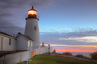 Pemaquid Point Lighthouse set against the pre-dawn sky which is  beginning to glow prior to sunrise, Bristol, Maine