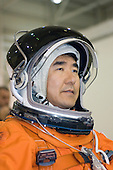 Houston, TX - June 14, 2007 -- Attired in a training version of his shuttle launch and entry suit, Japan Aerospace Exploration Agency (JAXA) astronaut Takao Doi, STS-123 mission specialist, awaits the start of a water survival training session in the Neutral Buoyancy Laboratory (NBL) near Johnson Space Center in Houston, Texas on June 14, 2007.  STS-123, flying aboard the Space Shuttle Endeavour, is scheduled for launch at 2:28 a.m. EDT Tuesday, March 11, 2008.  Its mission is to deliver the first pressurized component of the Japanese Kibo (Hope) Laboratory and a Canadian robotic device called Dextre utilizing 5 spacewalks.  Its 16-day flight is the longest shuttle mission to date..Credit: NASA via CNP