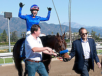February 5, 2011.Game On Dude, ridden by Chantal Sutherland, being led by part owner, Joe Torre, heading to the winner's circle after winning the San Antonio Stakes at Santa Anita Park, Arcadia, CA