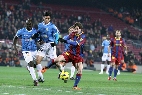 26.01.2011.  Spain, Copa del Rey semifinal FC BArcelona Beat UD Almeria at Camp Nou. Picture shows  Messi FCB and Vargas ALM challenge for the ball