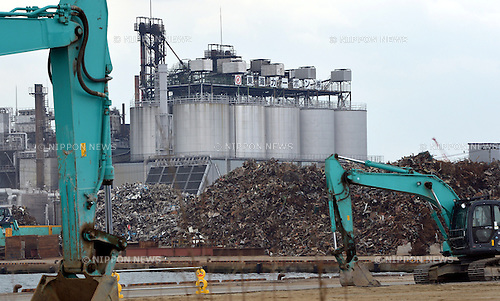 March 8, 2013, Ishinomaki, Japan - Against the backdrop of mounds of debris, earthmoving machines level the ground at the port of Ishinomaki, Miyagi Prefecture, on March 8, 2013. The port prospered as the major fishing port as well as the base for marine product processing industry. Two years ago on March 11, the Magnitude 9.0 earthquake and ensuing tsunami struck the nation's northeast region, leaving more than 15,000 people dead and ravaging wide swaths of coastal towns and villages.  (Photo by Natsuki Sakai/AFLO)