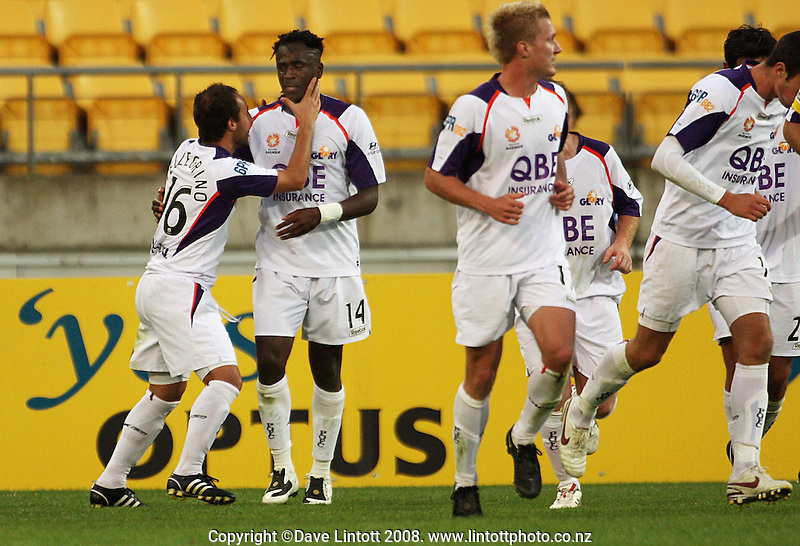 Adriano Pellegrino congratulates Eugene Dadi for scoring Perth's goal during the A-League football match between the Wellington Phoenix and Perth Glory at Westpac Stadium, Wellington, New Zealand on Saturday, 13 December 2008. Photo: Dave Lintott / lintottphoto.co.nz