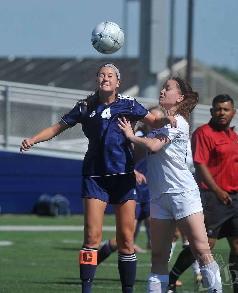 NWA Democrat-Gazette/MICHAEL WOODS &bull; @NWAMICHAELW<br /> Macy Watson (22) from Fayetteville and Keely Compton (4) from Heritage go after the ball Friday May 13, 2016 during the 7A State Soccer Tournament at Har-Ber High School in Springdale.