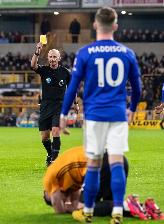Leicester City's James Maddison (right) receives a yellow card from referee Mike Dean for a challenge on Wolverhampton Wanderers' Matt Doherty <br /> <br /> Photographer Andrew Kearns/CameraSport<br /> <br /> The Premier League - Wolverhampton Wanderers v Leicester City - Friday 14th February 2020 - Molineux - Wolverhampton<br /> <br /> World Copyright © 2020 CameraSport. All rights reserved. 43 Linden Ave. Countesthorpe. Leicester. England. LE8 5PG - Tel: +44 (0) 116 277 4147 - admin@camerasport.com - www.camerasport.com
