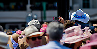 LOUISVILLE, KY - MAY 06: A fan reaches above the crowd to take a photo on Kentucky Derby Day at Churchill Downs on May 6, 2017 in Louisville, Kentucky. (Photo by Douglas DeFelice/Eclipse Sportswire/Getty Images)