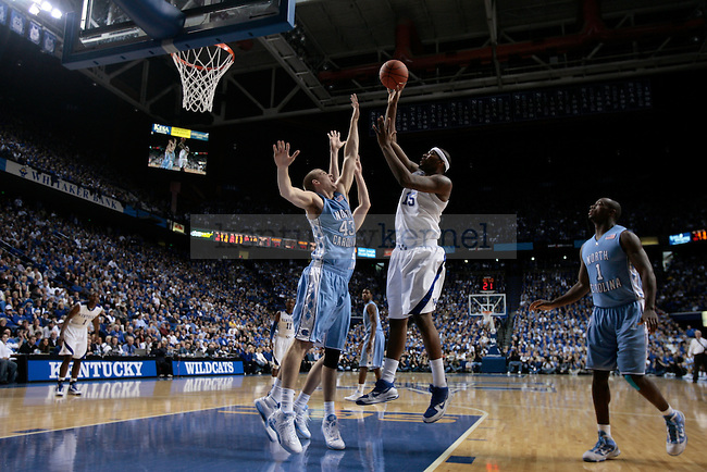 University of Kentucky freshman forward DeMarcus Cousins jumps over UNC forward Travis Wear in the second half of  UK's 68-66 win over UNC on Saturday, Dec. 5, 2009 in Rupp Arena...Photo by Ed Matthews | Staff