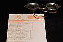 SAITAMA - DEC. 5: John Lennon's glasses and the notepaper from the New York Hilton Hotel on which he wrote the first draft of the lyrics for 'Imagine'. (Photo by Alfie Goodrich/Nippon News)