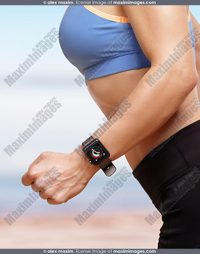 Woman jogging outdoors wearing Apple Watch smartwatch on her wrist displaying activity and exercise app