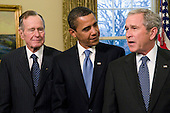 Washington, D.C. - January 7, 2009 -- United States President George W. Bush, right, makes a statement as former United States President George H.W. Bush, left; and United States President-elect Barack Obama, center, look on in the Oval Office of the White House in Washington, DC on Wednesday, January 7, 2009.  This was the first time all of the living past, present and future Presidents were at the White House together since 1981..Credit: Ron Sachs / Pool via CNP