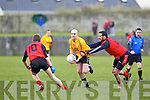 Listowel Emmets Brian Scanlon(15) tries to break past Ambrose Lanigan(10) and Shaun McGinley(8) Tarbert in the North Kerry Senior Football Final held last Sunday in Bob Stack Park, Ballybunion.