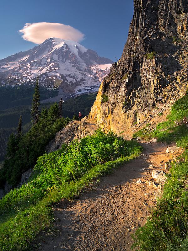 Path with hiker and Mt. Rainier with lenticular cloud. Mt. Rainier National Park, Washington